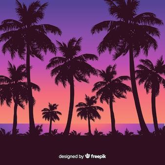 Coucher de soleil sur la plage avec des silhouettes de palmiers