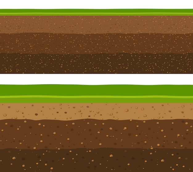 Couches d'herbe avec des couches de terre souterraines.