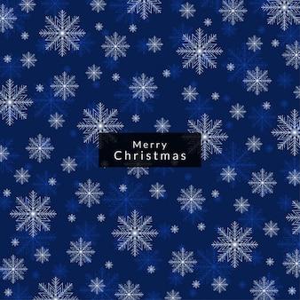 La couleur bleue de joyeux noël de fond avec des flocons de neige