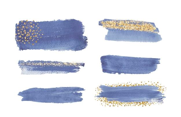 Coup de pinceau aquarelle bleu avec texture de paillettes d'or, confettis.