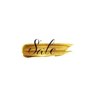 Coup de pinceau d'or dessiné à la main et texte vente