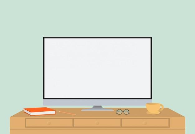Coupe d'ordinateur et agenda sur le bureau en bois