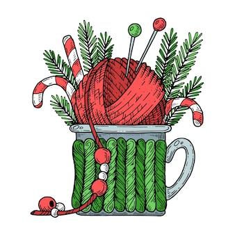 Coupe avec une pelote de fil à tricoter