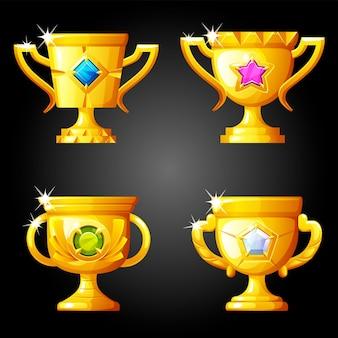 Coupes d'or de récompenses avec des pierres précieuses à jouer.