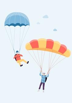 Couple actif âgé positif sautant avec parachute