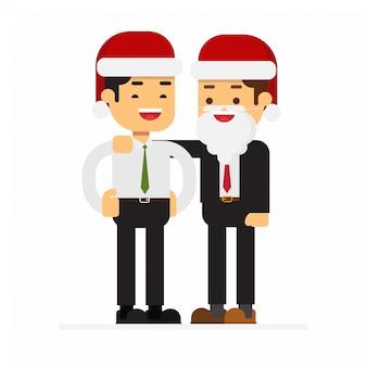 Couple d'affaires de noël debout ensemble boss étreignant l'épaule d'un employé