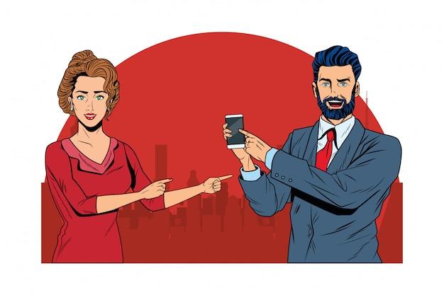 Couple d'affaires tenant un téléphone portable