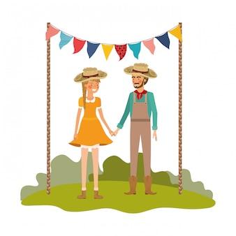 Couple d'agriculteurs parlant avec chapeau de paille dans le paysage
