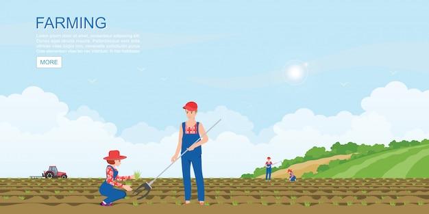 Couple d'agriculteurs plantant des plants de légumes.