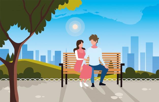Couple d'amoureux assis dans la chaise de parc