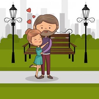 Couple amoureux sur la chaise de parc