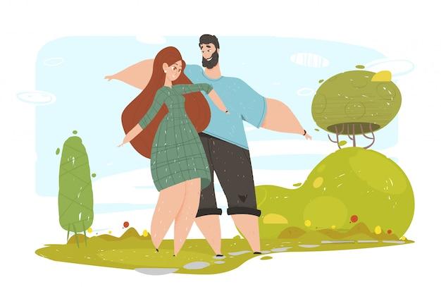 Couple d'amoureux heureux agitant les mains marchant dans le parc
