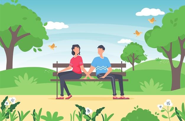 Couple assis ensemble dans le parc.