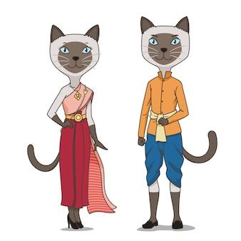 Couple de chats siamois de dessin animé portant un costume traditionnel thaïlandais.