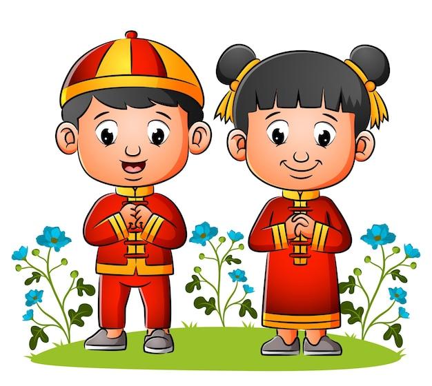 Le couple chinois donne la salutation de l'illustration