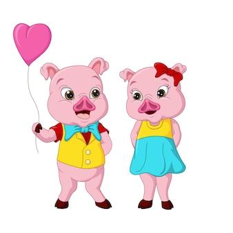 Couple de cochon mignon avec coeur ballon