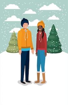 Couple d'hommes dans le paysage de neige avec des vêtements d'hiver