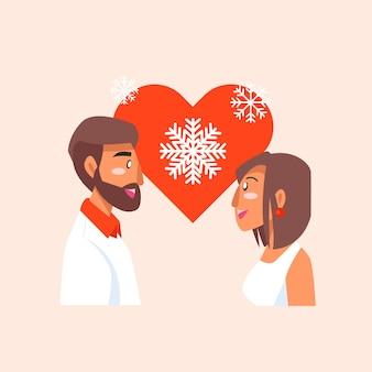 Couple debout et célébrant le noël ensemble et portant une tenue chaude en rouge blanc et noir