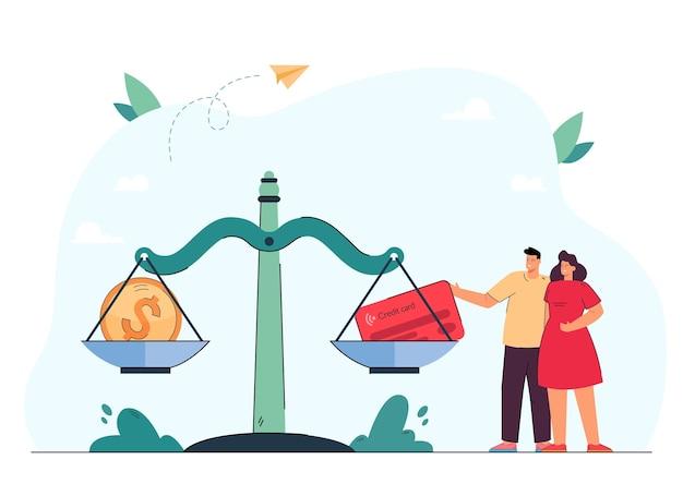 Couple debout à côté d'énormes balances avec pièce de monnaie et carte de crédit