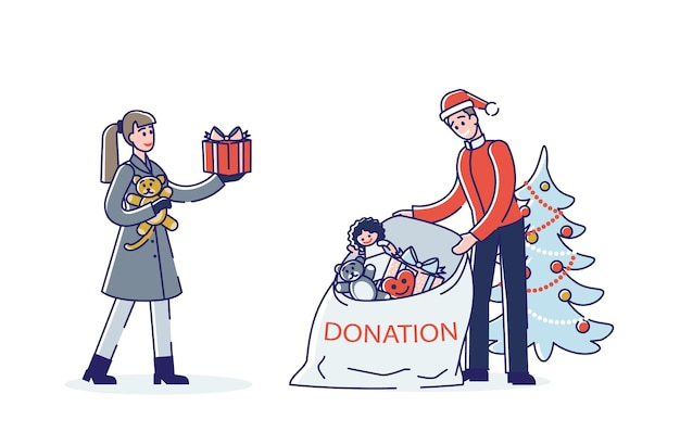 Couple donnant des jouets et des cadeaux pour les vacances de noël pour les enfants pauvres