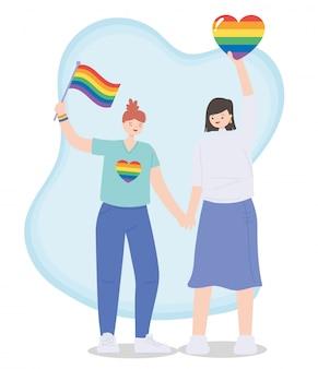Couple avec drapeau arc-en-ciel et coeurs