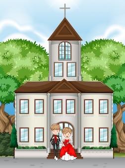 Couple sur une église le jour de leur mariage