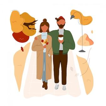 Couple élégant marchant dans le parc automne
