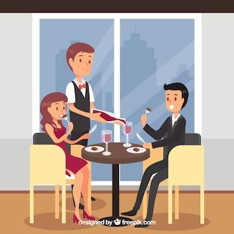 Couple élégant en train de dîner et de boire du vin