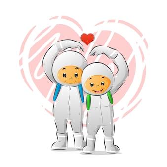 Le couple d'enfants utilisant l'équipement de protection individuelle avec sac de couleur