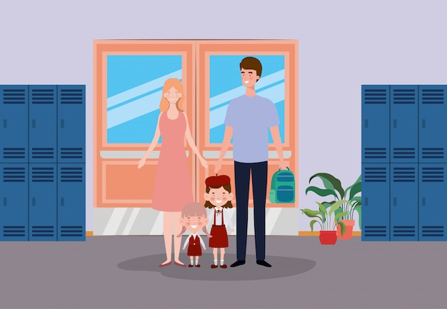 Couple enseignant avec petits élèves enfants dans le couloir de l'école