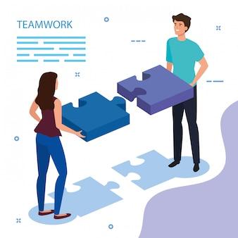 Couple équipe de travail avec des pièces de puzzle