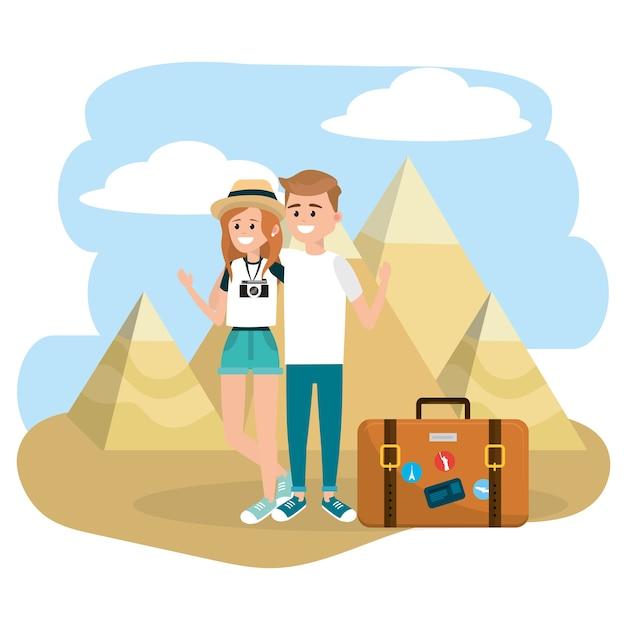 Couple femme et homme avec mallette et pyramides de giza