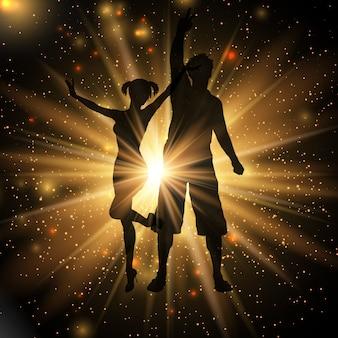 Couple de fête sur un fond de starburst or