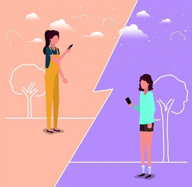 Couple de filles à l'aide de smartphone