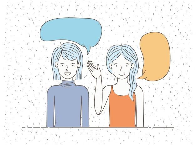 Couple de filles parlant avec des bulles