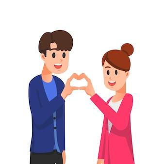Couple forme un signe d'amour avec leurs mains