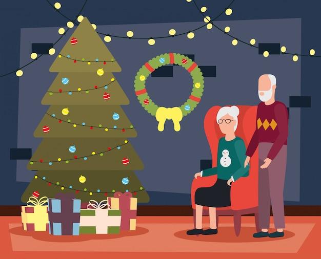 Couple de grands-parents dans la salle de séjour avec décoration de noël