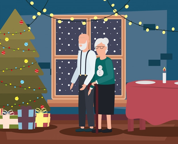 Couple de grands-parents dans le salon avec décoration de noël