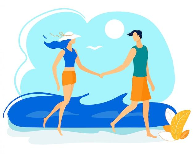 Couple heureux main dans la main, marchant le long du bord de mer.