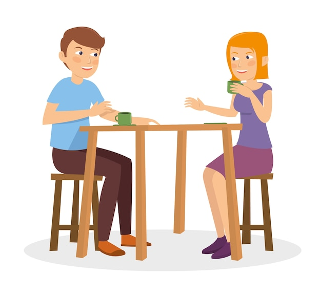 Un couple heureux parle et parle au restaurant