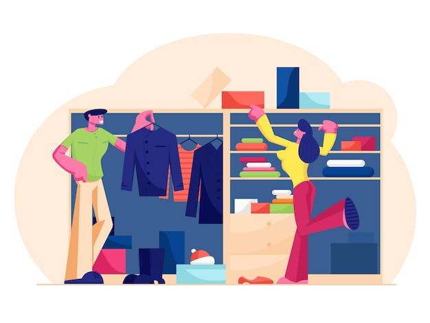 Couple d'homme et de femme debout à la garde-robe à la maison en choisissant la robe et les chaussures suspendues et allongées sur des étagères pour sortir. illustration plate de dessin animé