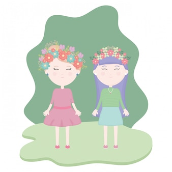 Couple de jolies filles avec une couronne florale dans les cheveux dans le champ
