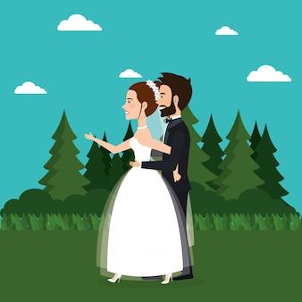 Couple juste marié dans le domaine