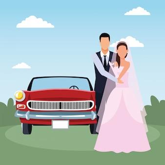 Couple juste marié debout et voiture classique rouge sur paysage