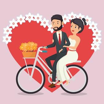 Couple juste marié en personnages d'avatars à vélo