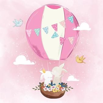 Couple de lapin dans la montgolfière