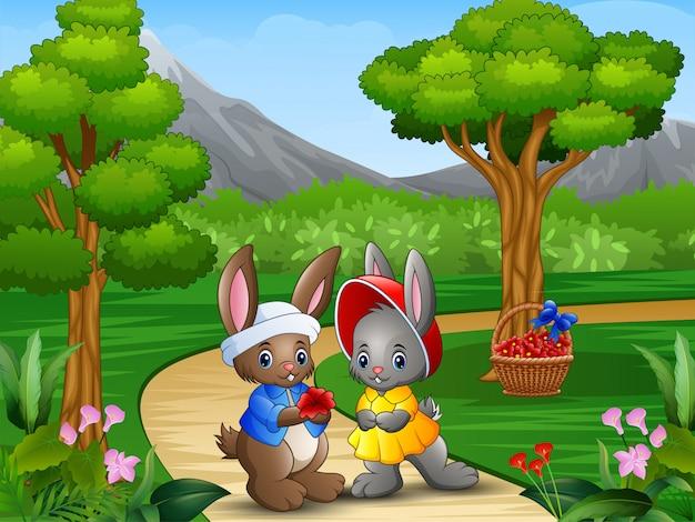 Couple de lapin de dessin animé le jour de la saint-valentin