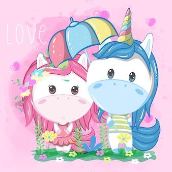 Couple de licorne sous un parapluie