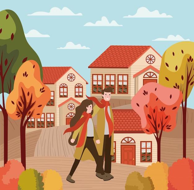 Couple marchant avec des costumes d'automne dans la ville