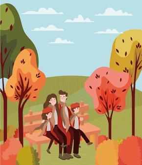Couple marchant avec des enfants assis dans une chaise de parc